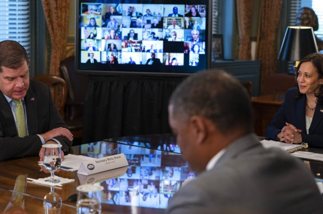 Vice President Kamala Harris, right, listens to Labor Secretary Marty Walsh, far left, during the inaugural meeting of the ... <a target=
