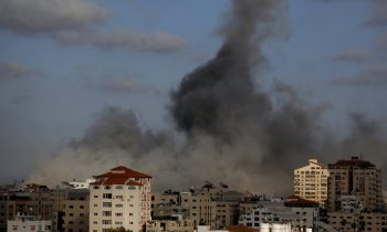CORRECTS THE DATE AND BUILDING INFORMATION - An Israeli air strike hits a building in Gaza City, Monday, May 17, 2021. The Israeli military unleashed a wave of heavy airstrikes Monday on the Gaza Strip, saying it destroyed 15 kilometers (9 miles) of militant tunnels and the homes of nine Hamas commanders as international diplomats worked to end the weeklong war that has killed hundreds of people. (AP Photo/Hatem Moussa)