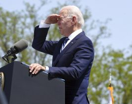 President Joseph R. Biden shades his eyes to survey the the crowd during the 140th commencement exercises for the United States Coast Guard Academy Wednesday, May 19, 2021 in New London, Conn. (Sarah Gordon/The Day via AP)