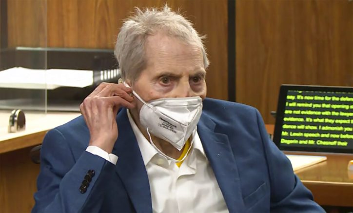 In this still image taken from the Law&Crime Network court video, real estate heir Robert Durst watches as his defense attorney Dick DeGuerin presents a new round of opening statements in the murder case against Durst after a 14-month recess due to the coronavirus pandemic in Los Angeles County Superior Court in Inglewood, Calif., on Wednesday, May 19, 2021. Durst, 78, an heir to a New York commercial real estate empire, is charged with first-degree murder in the slaying of his best friend, Susan Berman. (Law&Crime Network via AP, Pool)