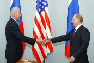 FILE - In this March 10, 2011, file photo, then Vice President Joe Biden, left, shakes hands with Russian Prime Minister Vladimir Putin in Moscow, Russia. President Joe Biden will hold a summit with Vladimir Putin next month in Geneva, a face-to-face meeting between the two leaders that comes amid escalating tensions between the U.S. and Russia in the first months of the Biden administration. (AP Photo/Alexander Zemlianichenko, File)