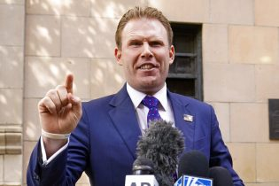 FILE — In this April 28, 2021 file photo, Andrew Giuliani, son of former New York Mayor Rudy Giuliani, speaks to reporters outside the building where his father lives, in New York. Andrew Giuliani announced Tuesday, May 18, 2021, that he is seeking the Republican nomination for governor of New York, potentially setting up a battle with third-term incumbent Democrat Andrew Cuomo.(AP Photo/Mary Altaffer, File)