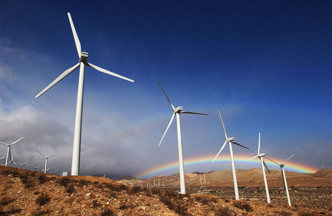 PALM SPRINGS, CA - NOVEMBER 9: The first storm of the season produces a rainbow behind wind turbines in the San Gorgonio Pass November 9, 2002 near Palm Springs, California. (Photo by David McNew/Getty Images)