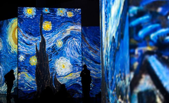 """People visit the exhibition """"Van Gogh Alive - The Experience"""", life and work of Vincent Van Gogh from 1880 until 1890 on February 02, 2018 in Sevilla. Photographs and videos combined with a unique system that incorporates over 50 high-definition projectors, graphics and multi-channel surround sound to create multi-screen environments showing the art of Vincent Van Gogh. / AFP PHOTO / CRISTINA QUICLER / RESTRICTED TO EDITORIAL USE - MANDATORY MENTION OF THE ARTIST UPON PUBLICATION - TO ILLUSTRATE THE EVENT AS SPECIFIED IN THE CAPTION (Photo credit should read CRISTINA QUICLER/AFP via Getty Images)"""
