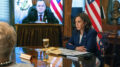 Kamala Harris meets virtually with Guatemala's President Alejandro Giammattei, seen on screen at left, Monday, April 26, 2021, from her ceremonial office at the Eisenhower Executive Office Building on the White House complex in Washington. (AP Photo/Jacquelyn Martin)