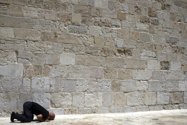 A Muslim worshipper takes part in Friday prayers at the Dome of the Rock Mosque in the Al-Aqsa Mosque compound in the Old City of Jerusalem, Friday, May 14, 2021. (AP Photo/Mahmoud Illean)