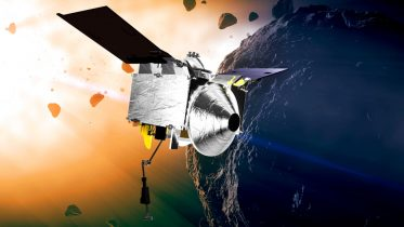FILE - This illustration provided by NASA depicts the OSIRIS-REx spacecraft at the asteroid Bennu. On Monday, May 10, 2021, the robotic explorer fired its engines, headed back to Earth with samples it collected from the asteroid, nearly 200 million miles away. (Conceptual Image Lab/Goddard Space Flight Center/NASA via AP)