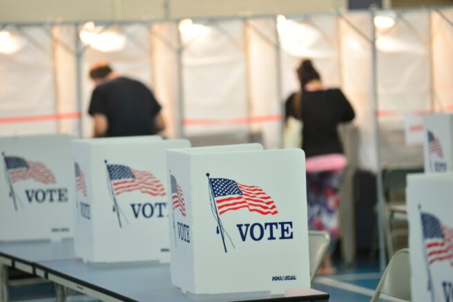 File- Voting booths are kept socially distant at the Chesterfield, N.H. polling site. (Kristopher Radder/The Brattleboro Reformer via AP Photo)