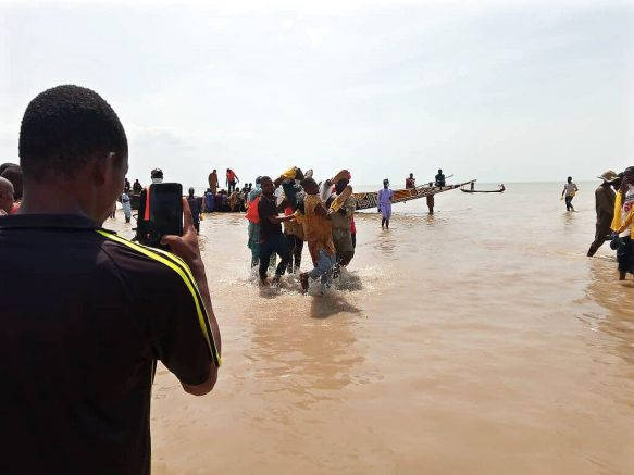 In this photo released by National Emergency Management Agency, rescued workers carry a victim of a boat accident in wara Kebbi , Nigeria, Thursday, May 27, 2021. More than 100 people are missing and feared dead after a boat with more than 165 passengers, including women and children, broke and sank as it was traveling in Nigeria's northern Kebbi state, officials said Wednesday.(National Emergency Management Agency/via AP)