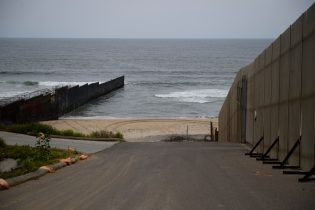 The border wall crosses the beach as it ends in the Pacific Ocean along the US-Mexico border between San Diego and Tijuana on May 10, 2021 at International Friendship Park in San Diego County, California. - Few issues have as long a history of bedeviling both Democrats and Republicans as immigration and asylum on the approximately 2,000-mile (3,000-kilometer) US-Mexico frontier. (Photo by Patrick T. FALLON / AFP) (Photo by PATRICK T. FALLON/AFP via Getty Images)