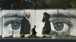 """FILE - In this May 5, 2020 file photo, graffiti depicts Washington's peace envoy Zalmay Khalilzad, left, and Mullah Abdul Ghani Baradar, the leader of the Taliban delegation, in Kabul, Afghanistan. After 20 years America is ending its """"forever"""" war in Afghanistan. The U.S. and NATO leave behind an Afghanistan that is at least half run directly or indirectly by the Taliban. (AP Photo/Rahmat Gul, File)"""