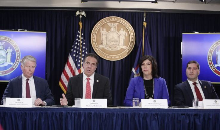 New York City District Attorney Cyrus Vance (left) New York Gov. Andrew Cuomo (second to the left) Nassau County District Attorney Madeline Singas (2nd to the right) and Suffolk County District Attorney Tim Sini (right) (Frank Franklin II/AP)