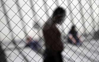 FILE - Immigrants sit in the sun in the health ward at the Otay Mesa immigration detention center in San Diego. (AP Photo/Gregory Bull, File)