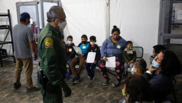 Migrants are processed at the intake area of the U.S. Customs and Border Protection facility, the main detention center for unaccompanied children in the Rio Grande Valley, in Donna, Texas, Tuesday, March 30, 2021. (AP Photo/Dario Lopez-Mills, Pool)