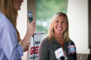 DALLAS, GA - OCTOBER 15: Sen. Kelly Loeffler (R-GA) speaks after being endorsed by Georgia Republican House candidate Marjorie Taylor Greene (R) during a joint press conference on October 15, 2020 in Dallas, Georgia. Greene has been the subject of some controversy recently due to her support for the right-wing conspiracy group QAnon. (Photo by Dustin Chambers/Getty Images)