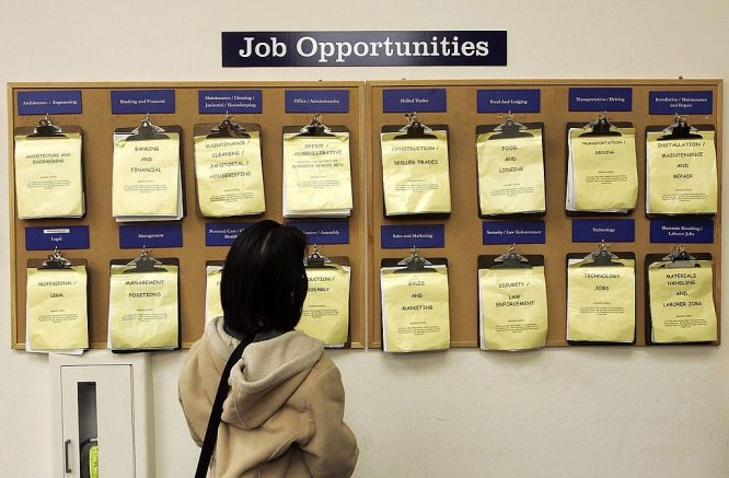 OAKLAND, CA - FEBRUARY 02: A job seeker looks at a job listing board at the East Bay Career Center February 2, 2006 in Oakland, California. According to a government report, U.S. unemployment benefits claims dropped to about 273,000 last week, sending a four-week average of claims to the lowest level in nearly six years. (Photo by Justin Sullivan/Getty Images)