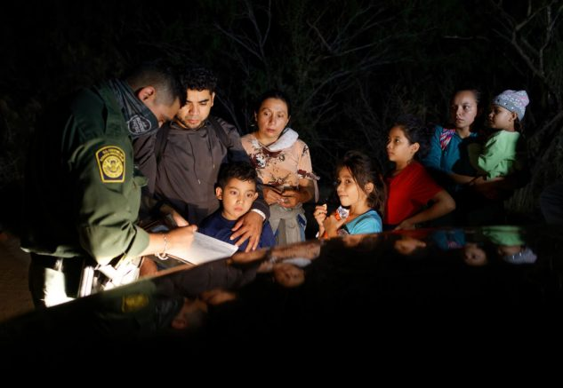 ROMA, TEXAS - APRIL 27 - A U.S. Border Patrol agent registers immigrants after they crossed the Rio Grande from Mexico on April 27, 2021 in Roma, Texas. A surge of mostly Central American immigrants crossing into the United States, including record numbers of children, has challenged U.S. immigration agencies along the U.S. southern border. (Photo by John Moore/Getty Images)