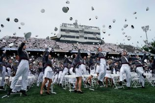 The Class of 2021 toss their hats into the air after they graduated at the US Military Academy's graduation ceremony at Michie Stadium West Point, New York on May 22,2021. (Photo by TIMOTHY A. CLARY / AFP) (Photo by TIMOTHY A. CLARY/AFP via Getty Images)
