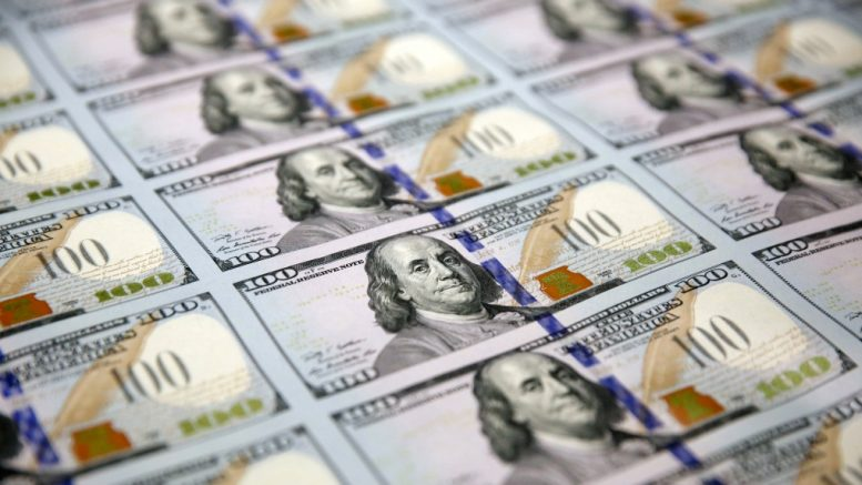 A sheet of uncut $100 bills makes the way through the printing process at the Bureau of Engraving and Printing Western Currency Facility in Fort Worth, Texas on Sept. 24, 2013 file photo. (AP / LM Otero)