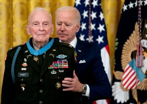 WASHINGTON, DC - MAY 21: U.S. President Joe Biden presents the Medal of Honor to Army Colonel Ralph Puckett in the East Room of the White HouseMay 21, 2021 in Washington, DC.. Army Colonel Ralph Puckett is a decorated combat veteran who served in the army during the Korean War and led a group of 51 men in the capture and defense of Hill 205 against an overwhelming Chinese attack. Colonel Puckett is President Joe Biden's first Medal of Honor recipient of his administration. (Photo by Stefani Reynolds-Pool/Getty Images)