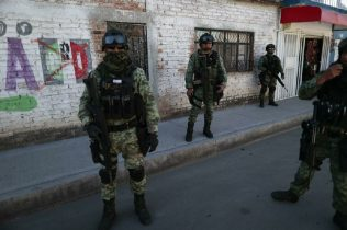 Soldiers patrol a neighborhood in Irapuato, Guanajuato state, Mexico, in February. (AP/Rebecca Blackwell)