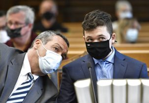 Kyle Rittenhouse, right, listens to his attorney, Mark Richards, during Rittenhouse's pretrial hearing Friday, May 21, 2021 at the Kenosha County Courthouse in Kenosha, Wis. Rittenhouse's attorneys and prosecutors are expected to iron out deadlines and other housekeeping matters ahead of his trial in November. Rittenhouse is charged with killing two men and wounding a third during the August protests. (Sean Krajacic/The Kenosha News via AP, Pool)