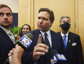 Florida Gov. Ron DeSantis responds to local TV reporter's question after he signed legislation seeking to punish social media platforms that remove conservative ideas from their sites at Florida International University's's MARC building in Miami on Monday, May 24, 2021. (Carl Juste/Miami Herald via AP)