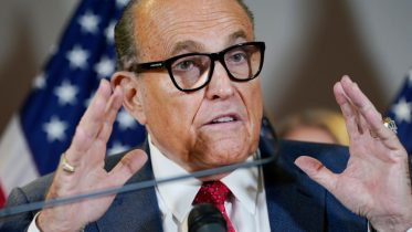FILE - In this Nov. 19, 2020, file photo, former New York Mayor Rudy Giuliani speaks during a news conference at the Republican National Committee headquarters in Washington. Federal agents raided Giuliani's Manhattan home and office on Wednesday, April 28, 2021, seizing computers and cellphones in a major escalation of the Justice Department's investigation into the business dealings of former President Donald Trump's personal lawyer. (AP Photo/Jacquelyn Martin, File)
