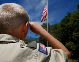 PAYSON, UT - JULY 31: A Boy Scout salutes the American flag at camp Maple Dell on July 31, 2015 outside Payson, Utah. The Mormon Church is considering pulling out of its 102 year old relationship with the Boy Scouts after the Boy Scouts changed it's policy on allowing gay leaders in the organization. Over 99% of the Boy Scout troops in Utah are sponsored by the Mormon Church. (Photo by George Frey/Getty Images)