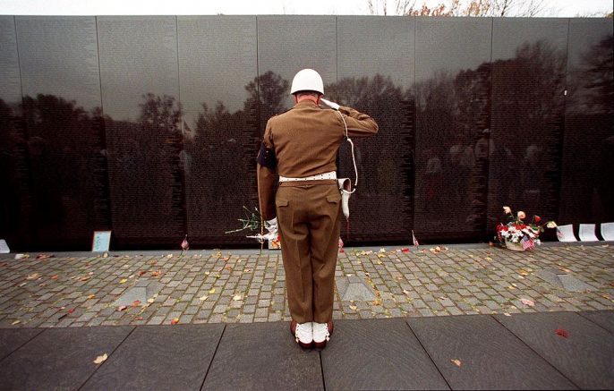 WASHINGTON, : Claudius M. Lehmann, a US Army World War II and Korean War veteran from Ashburn, VA salutes after placing a red carnation at the Vietnam Memorial Wall 11 November, 1999 in Washington, DC. Lehmann placed flowers along the wall in observance of Veteran's Day. AFP PHOTO (Photo credit should read TIM SLOAN/AFP via Getty Images)