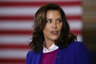 SOUTHFIELD, MICHIGAN - OCTOBER 16: Gov. Gretchen Whitmer introduces Democratic presidential nominee Joe Biden delivers remarks about health care at Beech Woods Recreation Center October 16, 2020 in Southfield,m Michigan. With 18 days until the election, Biden is campaigning in Michigan, a state President Donald Trump won in 2016 by less than 11,000 votes, the narrowest margin of victory in the state's presidential election history. (Photo by Chip Somodevilla/Getty Images)