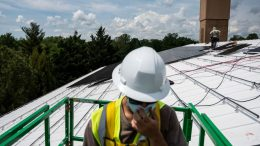 """Employees with Ipsun Solar install solar panels on the roof of the Peace Lutheran Church in Alexandria, Virginia on May 17, 2021. - Using donations, the church installed a 60.48 kilowatt solar instillation to bring down their carbon footprint. US President Joe Biden has called for the US energy sector to be fully decarbonized by 2035. To this end, he has asked Congress for $100 billion to invest in the national grid and shift to cleaner energy, as well as a ten-year extension of tax credits for renewable generation and storage. """"The tax credit for wind and solar has been quite successful in creating a large scale investment and build out,"""" Dan Lashof, president of the World Resources Institute told AFP, welcoming the extension. (Photo by Andrew CABALLERO-REYNOLDS / AFP) (Photo by ANDREW CABALLERO-REYNOLDS/AFP via Getty Images)"""