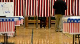 People cast their votes in the presidential primary at Windham High School in Windham, N.H., Tuesday, Feb. 9, 2016, during the New Hampshire primary. (AP Photo/Jacquelyn Martin)