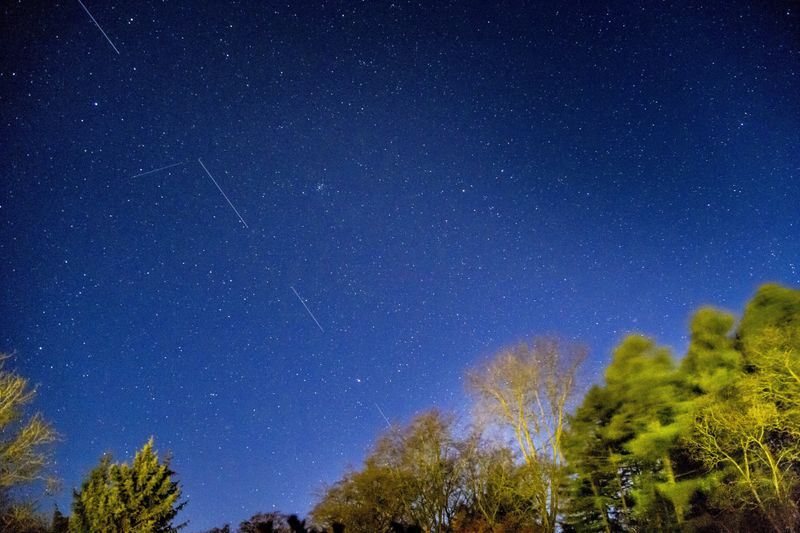 SpaceX Starlink 5 satellites are pictured in the sky seen from Svendborg