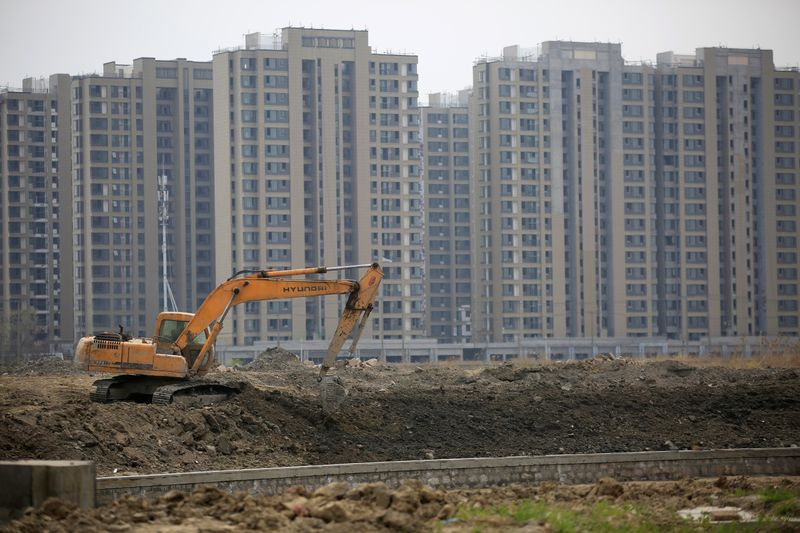FILE PHOTO: File photo of an excavator at a construction site of new residential buildings in Shanghai