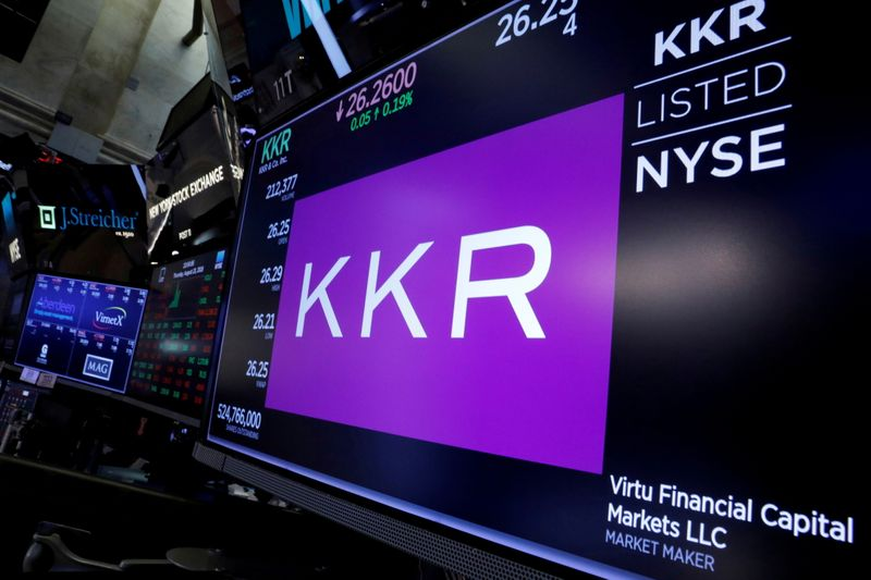 FILE PHOTO: Trading information for KKR & Co is displayed on a screen on the floor of the NYSE in New York