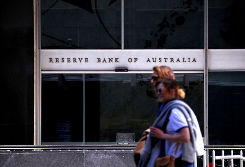 FILE PHOTO: Pedestrians walk past the main entrance to the Reserve Bank of Australia head office in central Sydney, Australia