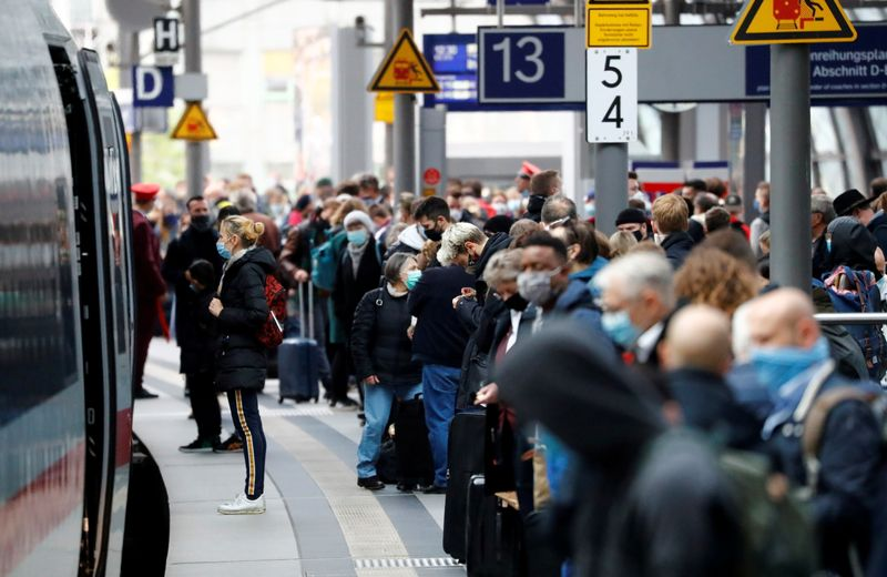 FILE PHOTO: Commuters wait at main train station Hauptbahnhof as the spread of the coronavirus disease (COVID-19) continues in Berlin