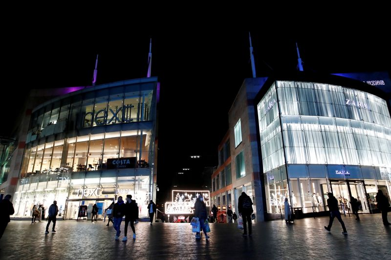 FILE PHOTO: Shoppers are seen walking near Bullring shopping centre, owned by mall operator Hammerson, in Birmingham
