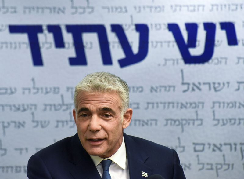 Yair Lapid, leader of Yesh Atid party, delivers a statement in Jerusalem