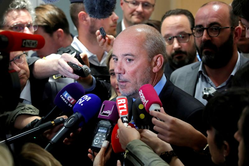 FILE PHOTO: Orange chief executive Stephane Richard speaks to reporters inside the courthouse in Paris