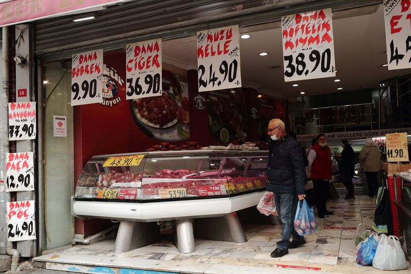 People shop at a meat store in Fatih district in Istanbul