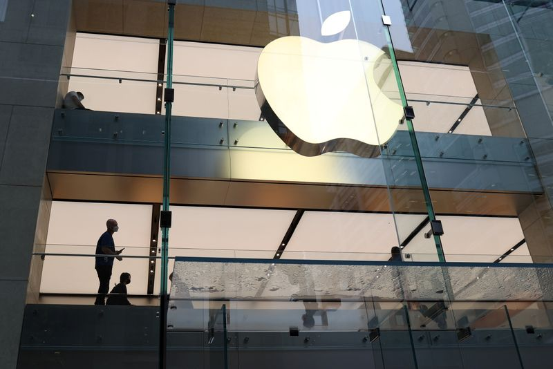 FILE PHOTO: Customers and staff wear protective masks inside an Apple Store in Sydney