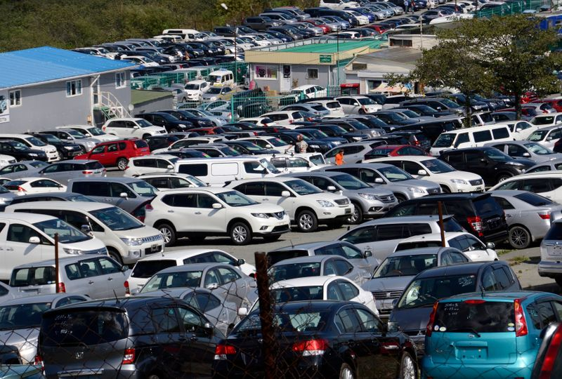 Used cars for sale are on display at an open air automobile market in the far eastern city of Vladivostok