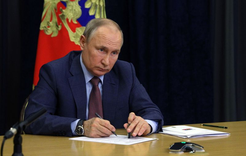 Russian President Vladimir Putin chairs a meeting with leaders of the United Russia party in Sochi