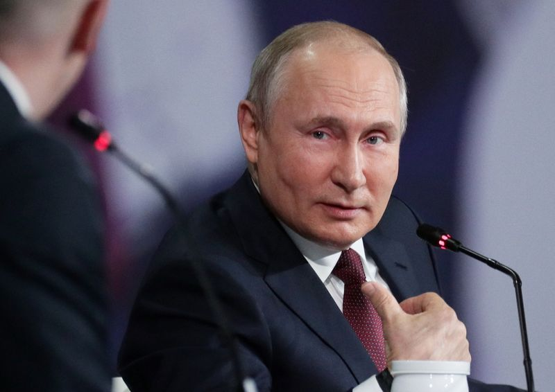 Russian President Putin attends a session of the St. Petersburg International Economic Forum