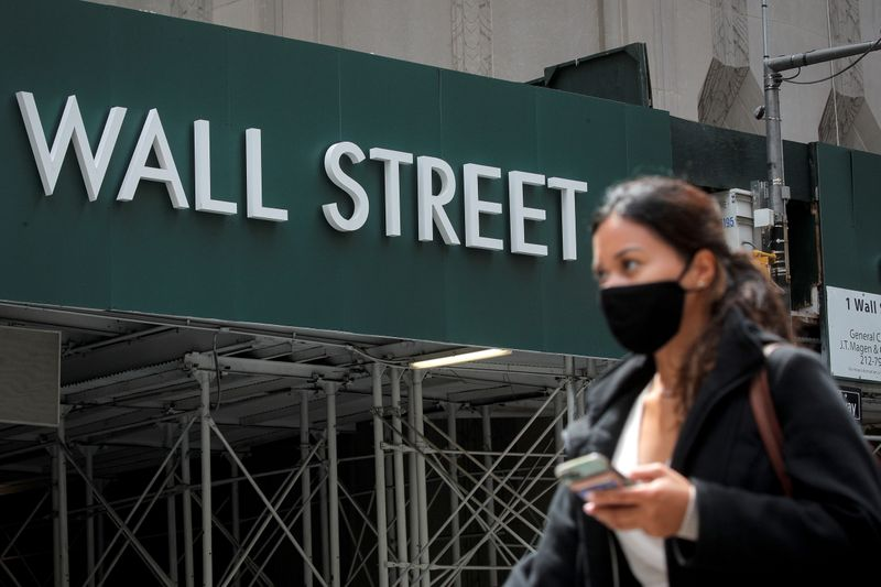 A Wall St. sign is seen near the NYSE in New York