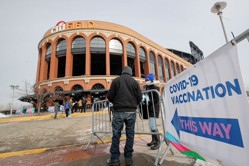 A man arrives to receive the coronavirus disease (COVID-19) vaccine outside Citi Field, the home stadium of MLB's New York Mets in Queens, New York