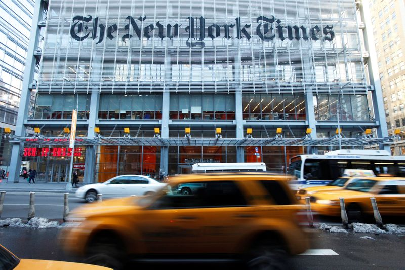 FILE PHOTO: Vehicles drive past the New York Times headquarters in New York