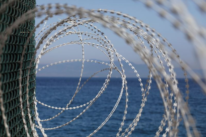 FILE PHOTO: The border fence separating Spain's northern enclave Ceuta and Morocco is seen from Ceuta